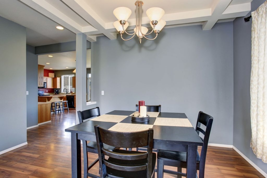 43014260-simplistic-dinning-room-with-gray-walls-and-black-table-chair-set